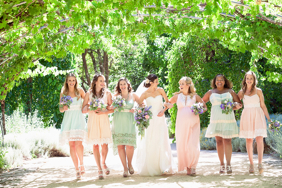 Bridesmaids walking at Campovida wedding