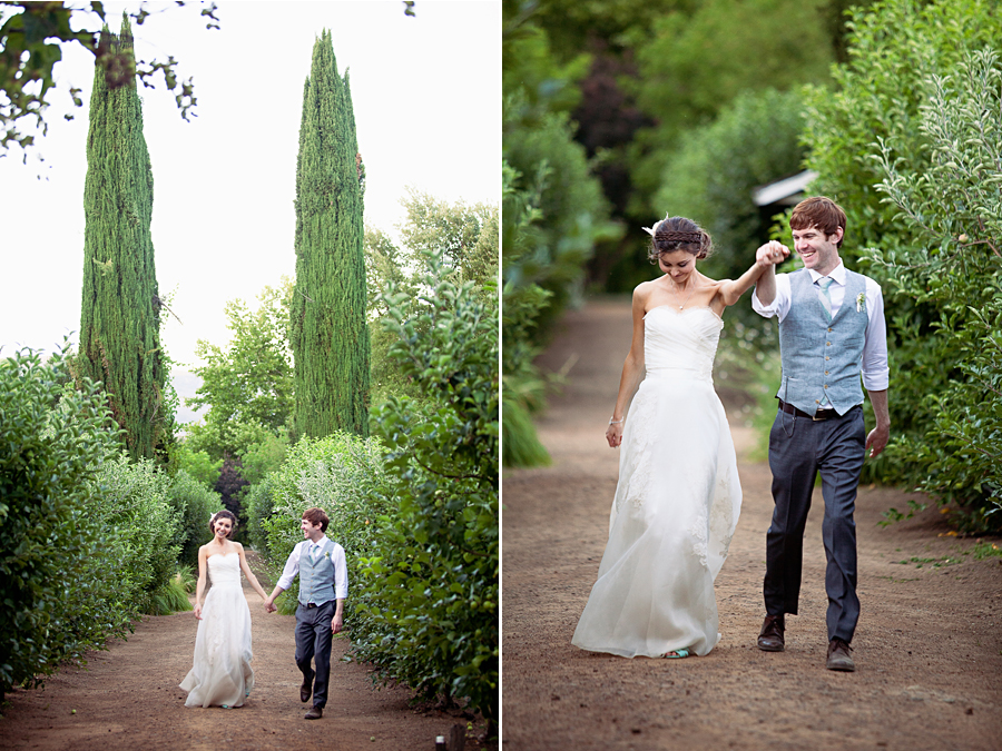 Bride and groom skipping at outdoor wedding