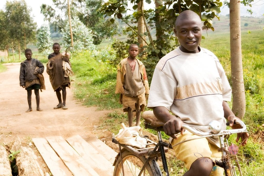 Rwandan on Bike. Picture for Project Rwanda Charity