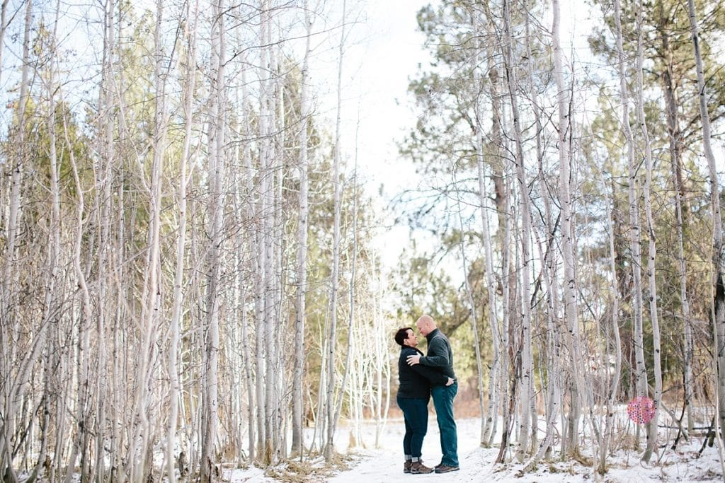 Bend Oregon Engagement couple in the snowy aspen trees