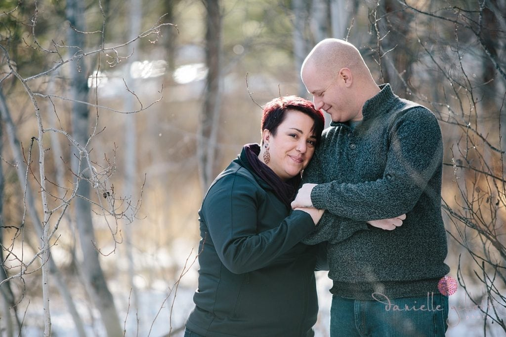 Couple cuddling in the trees in Bend Oregon engagement photos