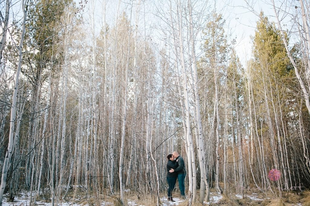 Couple hiding in Aspen trees in Bend Oregon engagement photos