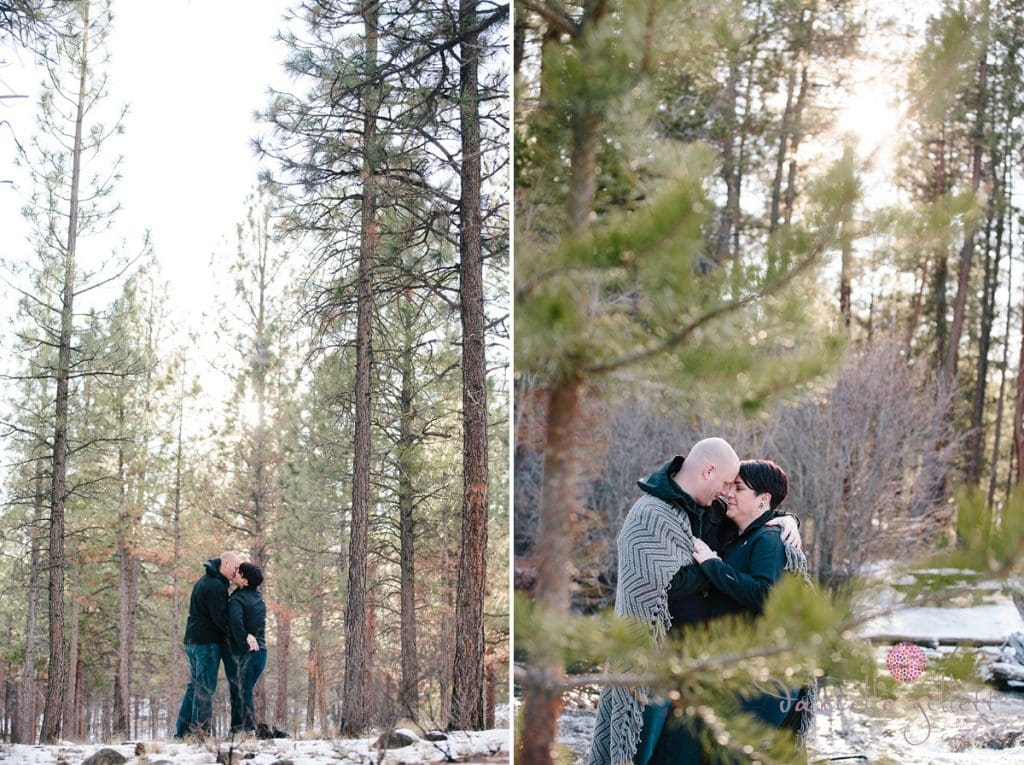couple wraped in a blanket in the trees at Shevlin Park Bend Oregon engagement photos