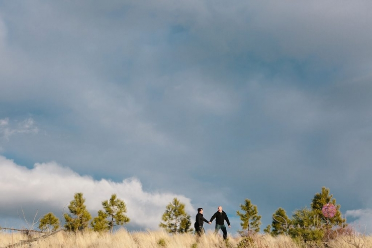 Couple walking on a mountain top from Bend Oregon engagement photos