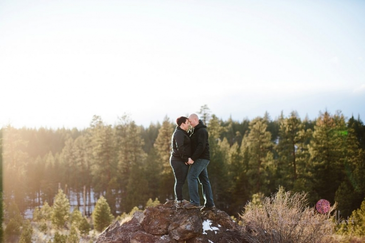 Engagement couple standing on a rock in Bend Oregon engagement photos