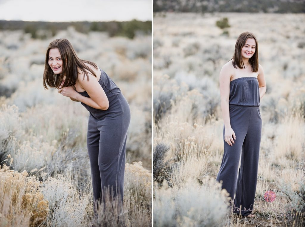girl wearing jumper in desert for senior picture