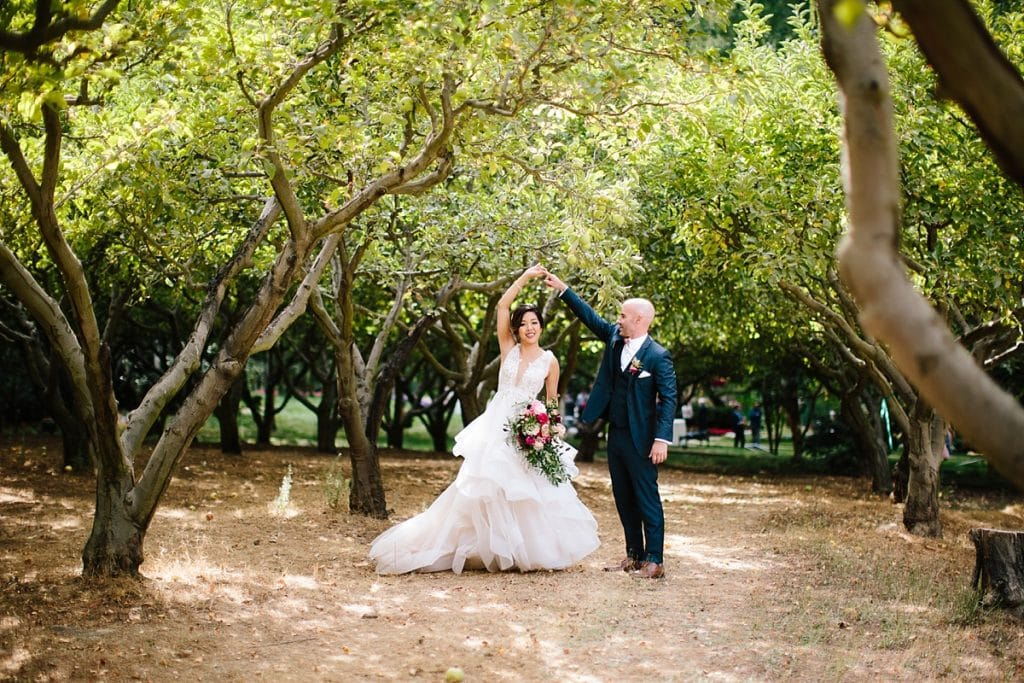 Nestldown Wedding Photography Bride and Groom dancing in orchard