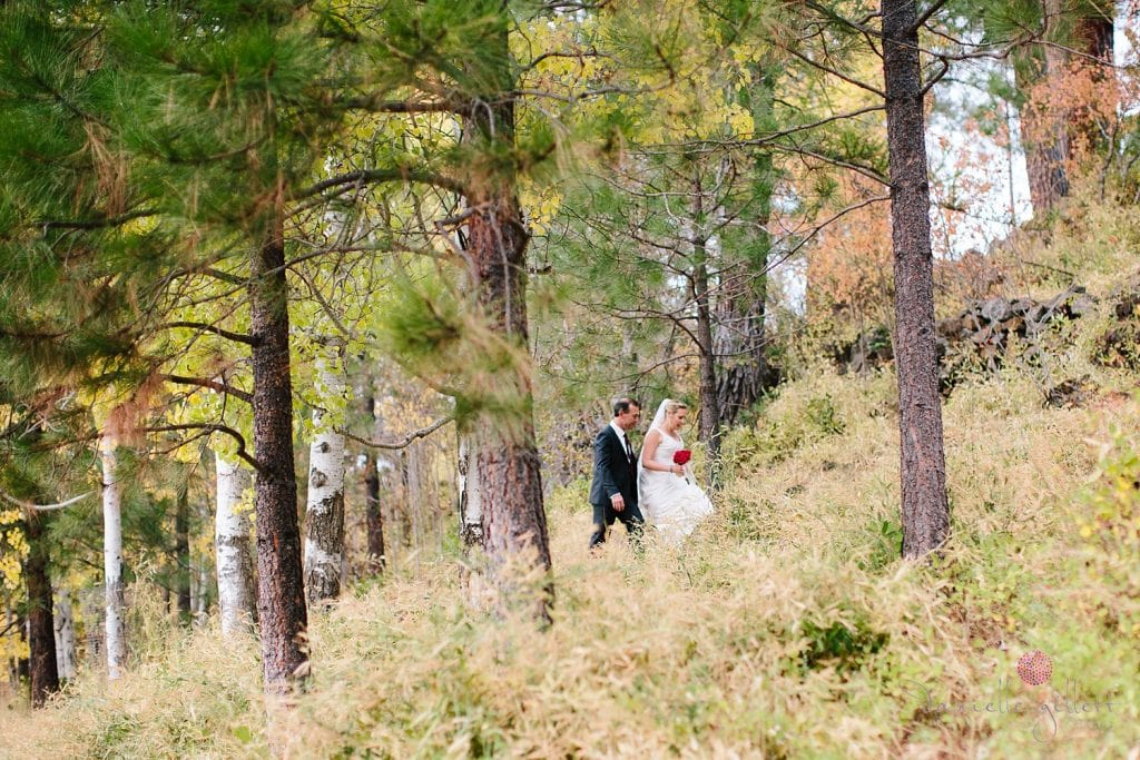 Bend wedding at House on Metolious. Fall Wedding. Bride and Groom walking by Metolious River