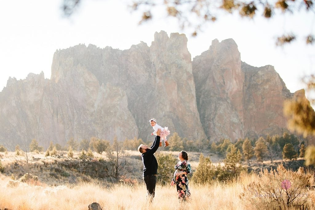 Bend Oregon Family Photography at Smith Rock. Dad playing with baby